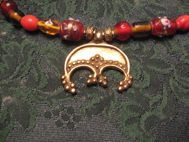 Close up - brass lunik pendant